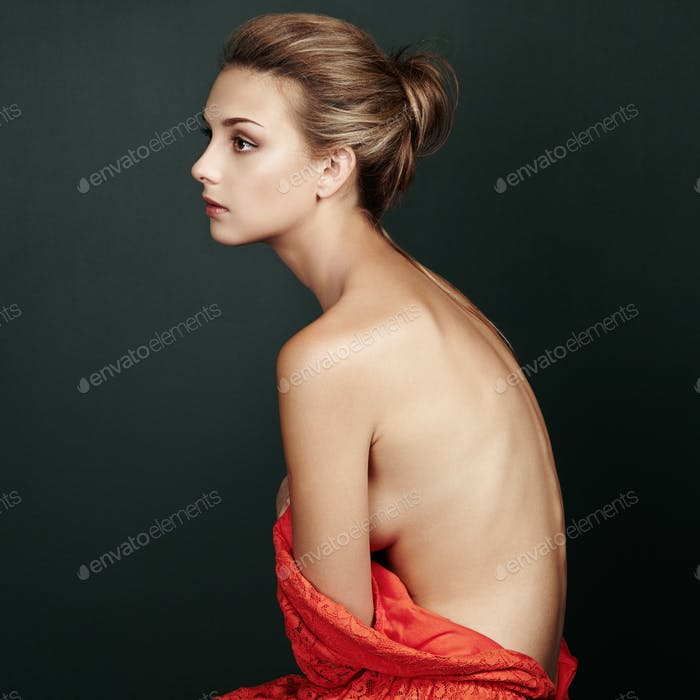 Fashion portrait of beautiful woman in elegant red dress