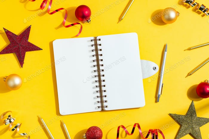 New Year card with paper notebook and holiday decoration