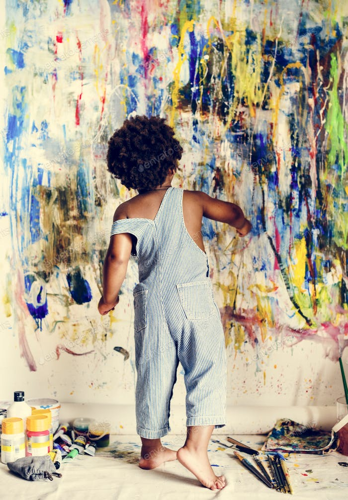 Black kid enjoying his painting
