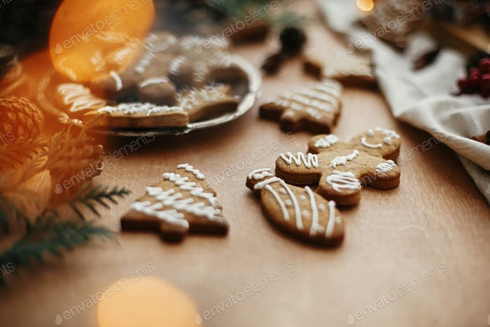 Christmas gingerbread cookies on vintage plate and anise, cinnamon, pine cones