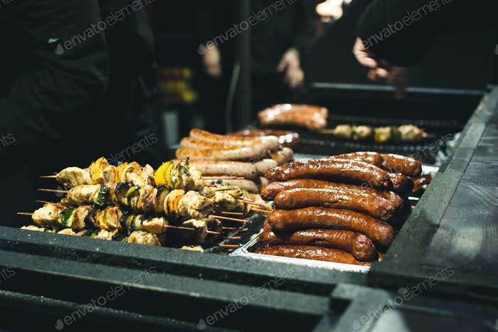 Grilled saussages and skewers at street food market