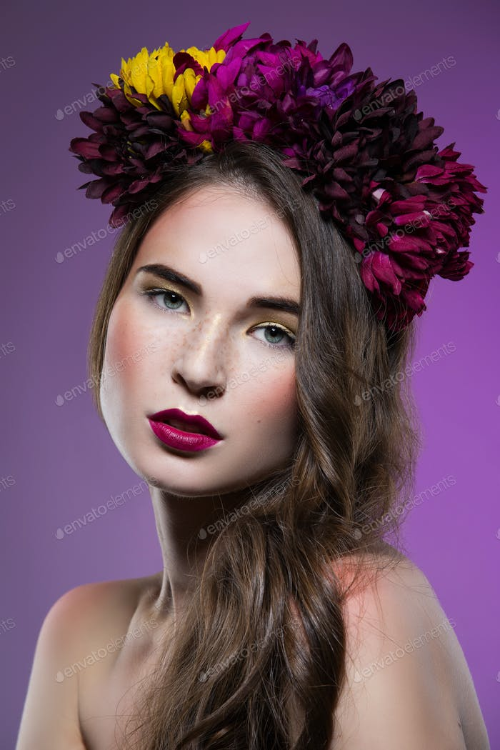 Beautiful girl with flowers on head