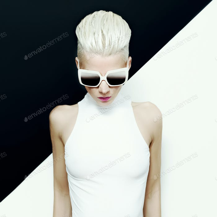 fashion photo. blond model with trendy hairstyle.