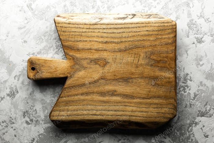 Old oak wood board on grunge concrete table