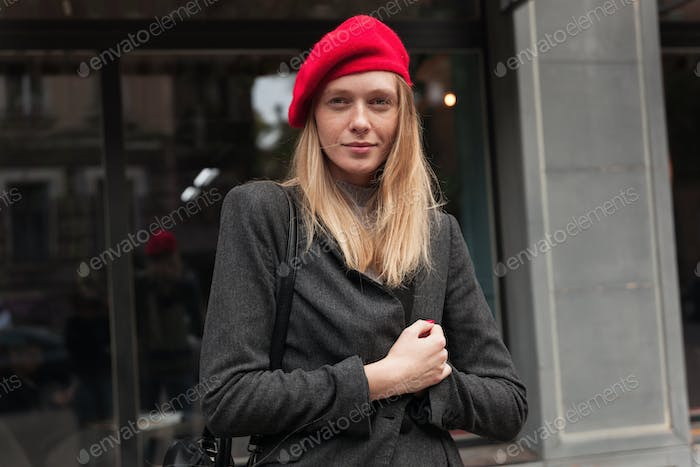 Portrait of young pretty blonde lady dressed in trendy clothes posing