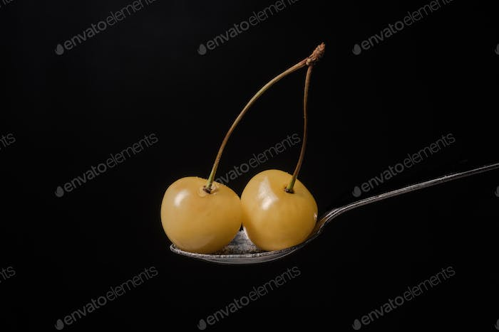 Sweet cherry isolated over black background.