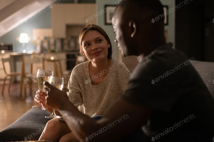 Happy lady enjoying wine wine black man