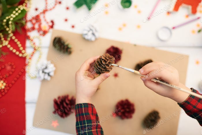 Covering Pinecone with Gouache