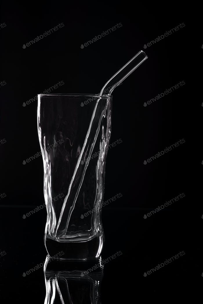 Empty glass silhouette isolated on dark background
