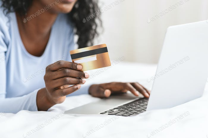 Young woman making online purchases from home
