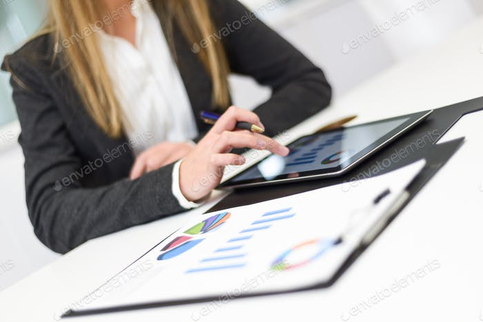 Businesswoman with tablet computer in the office