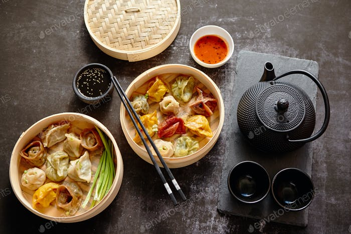 Oriental traditional chinese dumplings served in the wooden steamer