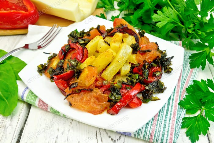 Courgettes with vegetables in plate on table
