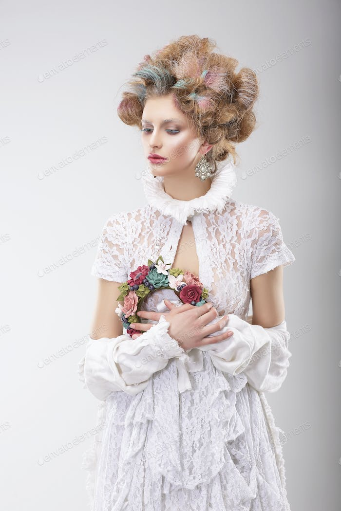 Personality. Luxurious Woman with Flowers in Evening Costume