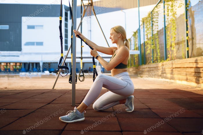 Smiling woman doing stretching exercise outdoors