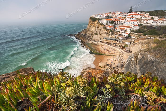 Sintra, Lisbon, Portugal. Azenhas do Mar white village landmark on the cliff and Atlantic ocean