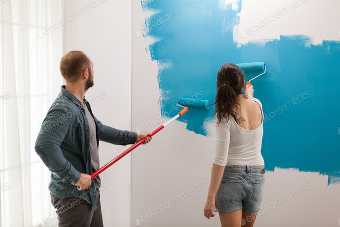 Young artists decorating a children's room