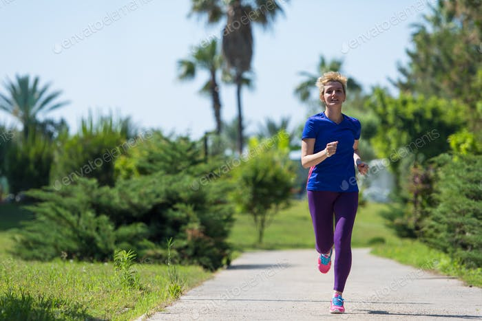 young female runner training for marathon