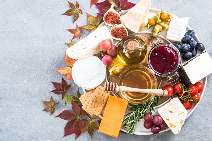 Cheese platter with all kinds of cheese and fruits