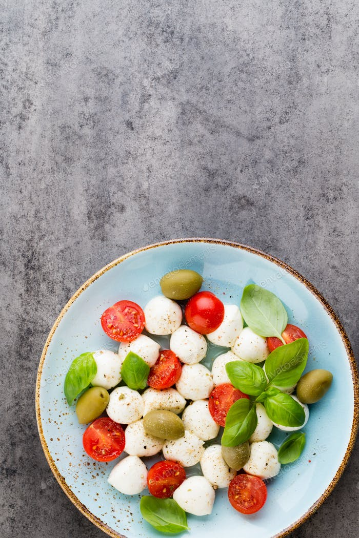Cherry tomatoes, mozzarella cheese, basil and spices