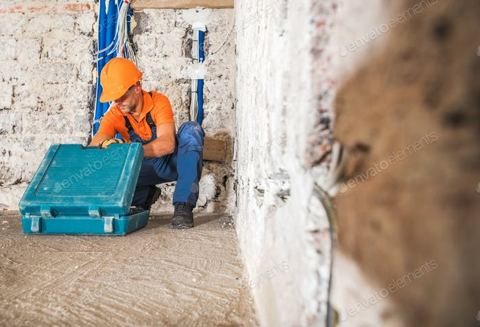 Construction Worker Inside Remodeled Concrete House Interior