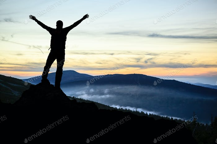 Thumbnail for Man hiker successful with arms outstretched