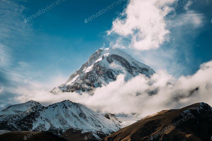 Georgia. Peak Of Mount Kazbek Covered With Snow. Kazbek Is A Str