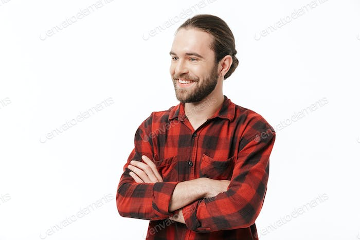 Bearded man posing isolated over white wall background.