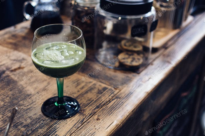 Iced matcha cocktail in cafe