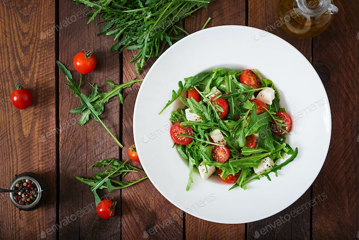 Vitamin Salad of fresh tomatoes, arugula, feta cheese and peppers