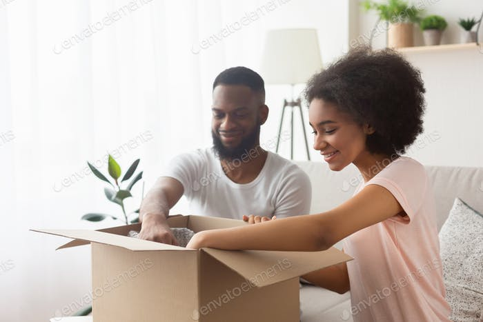 African american couple happy from purchase at online store