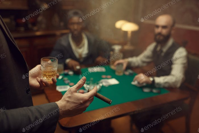 Three poker players sitting at the table, casino