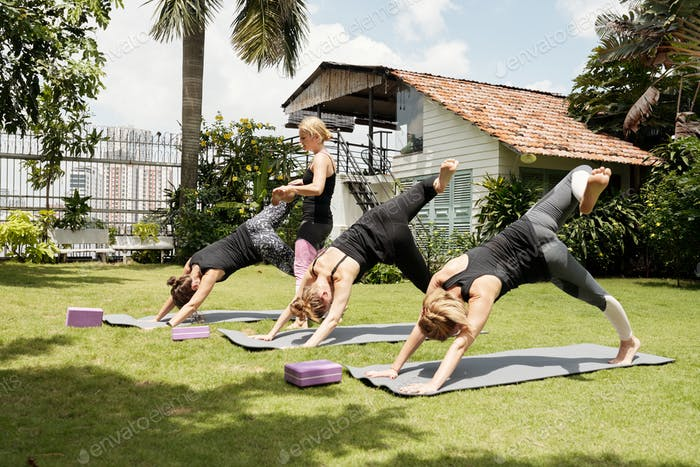 Sportswomen Practicing Scorpion Kick
