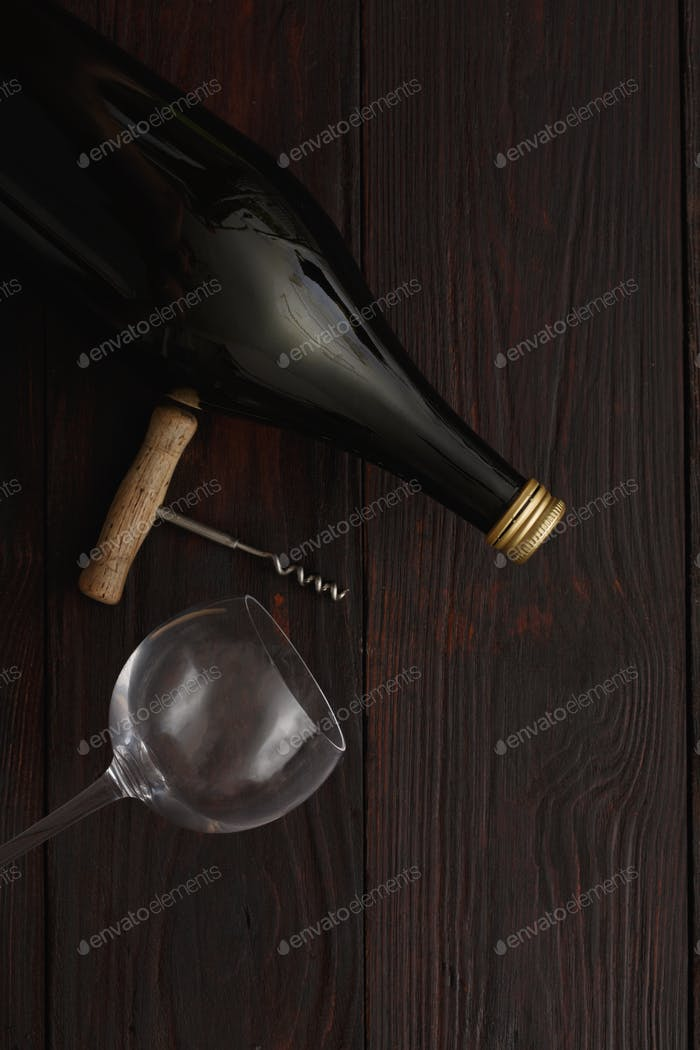 Red wine bottle, glass, corkscrew, flat lay