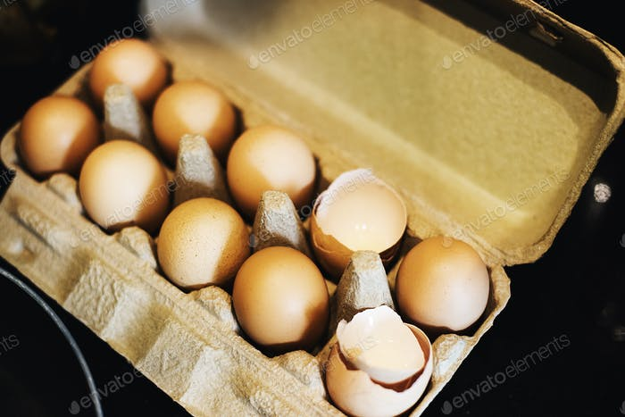 Closeup of chicken eggs in paper box