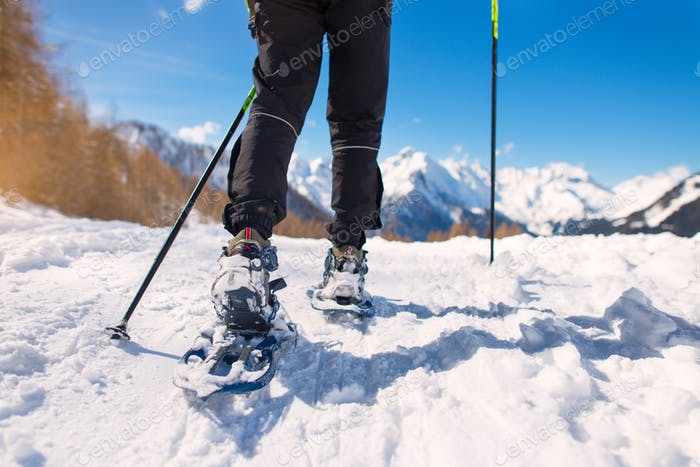 Mountain hike with snowshoes
