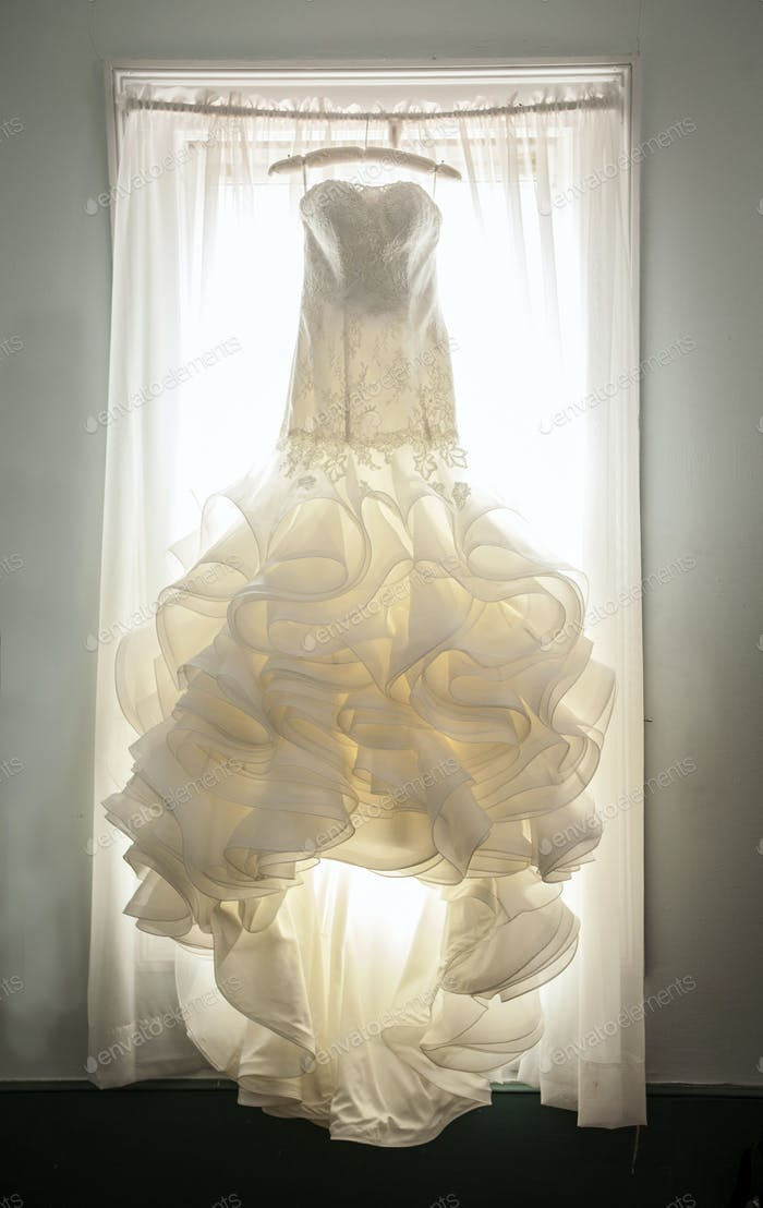 extravagant wedding dress in window