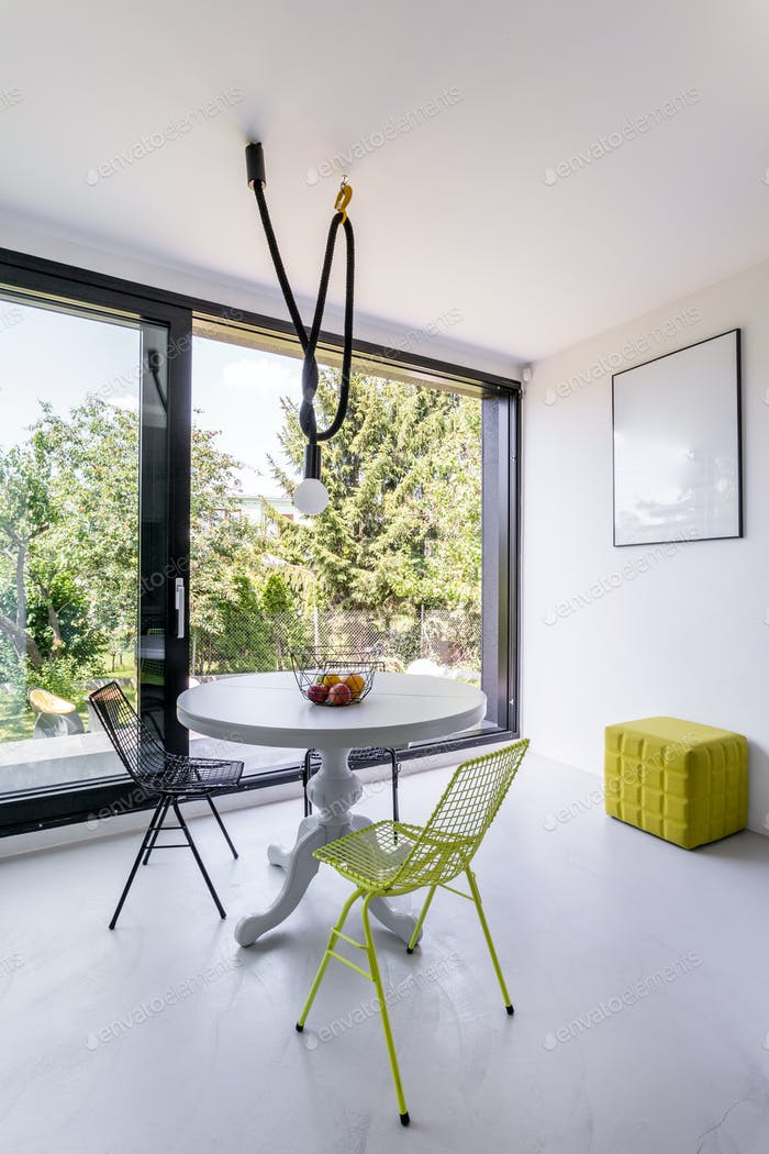 Bright dining room with panoramic window