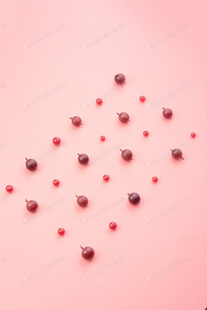 Berries isolated over pink background table.