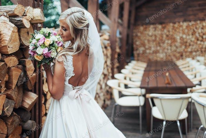 Portrait of gorgeous bride with a wedding bouquet