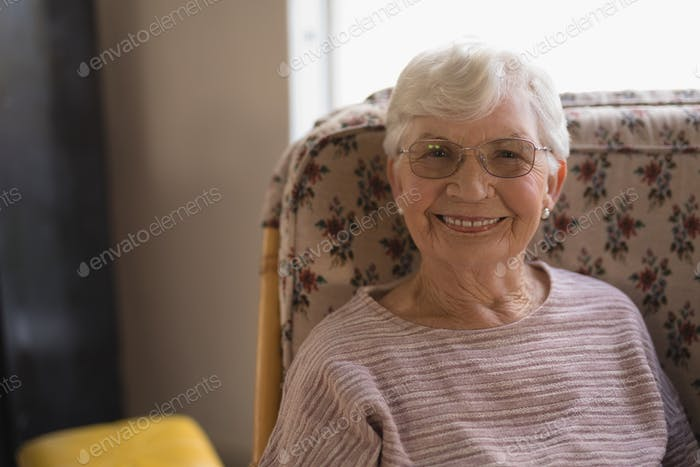Front view of happy senior woman looking at camera in nursing  home