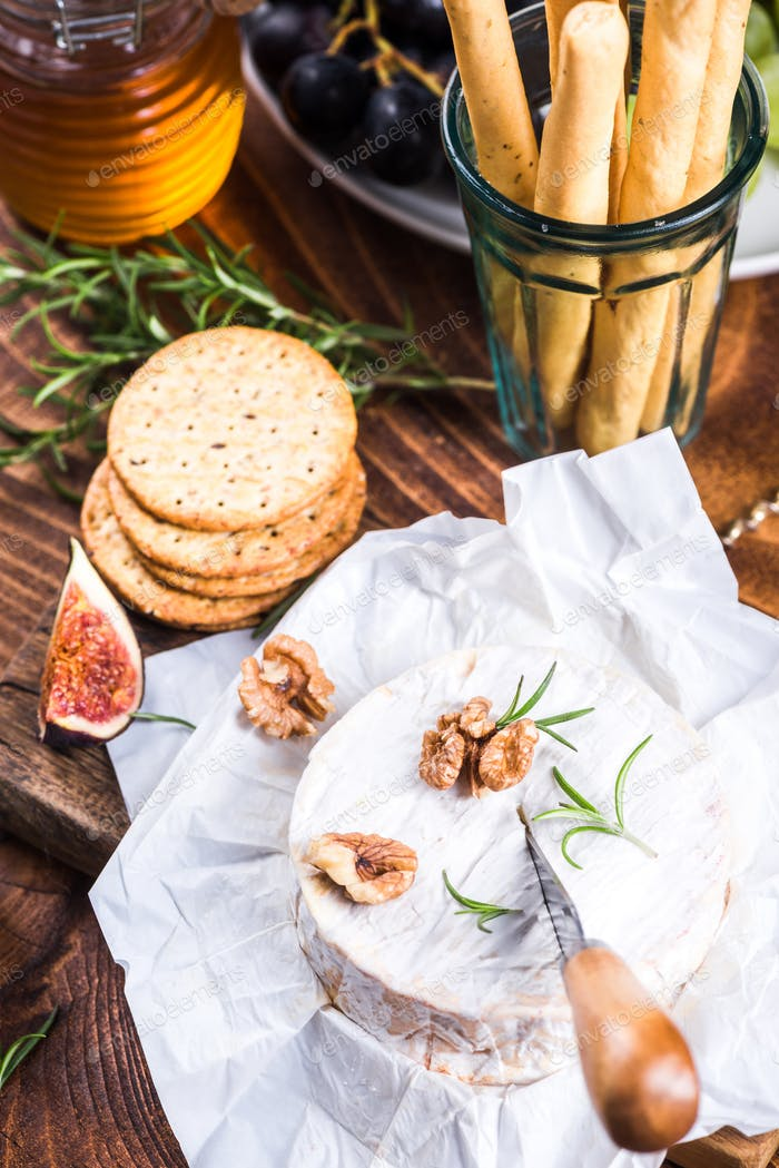 Serving camembert cheese, festive Christmas food
