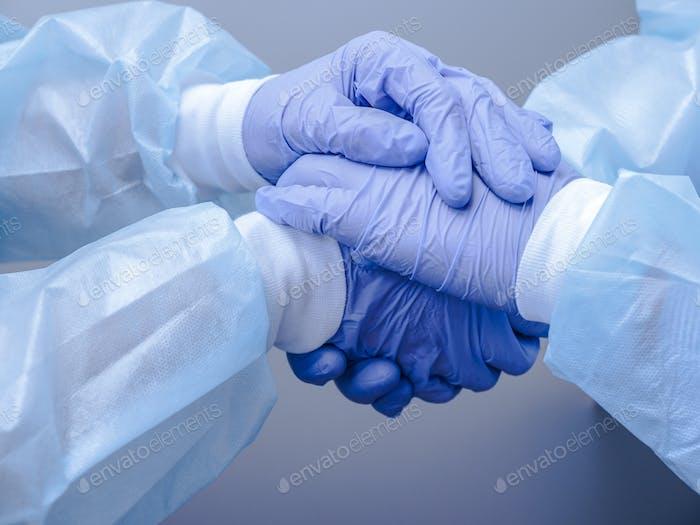 Doctors shake hands