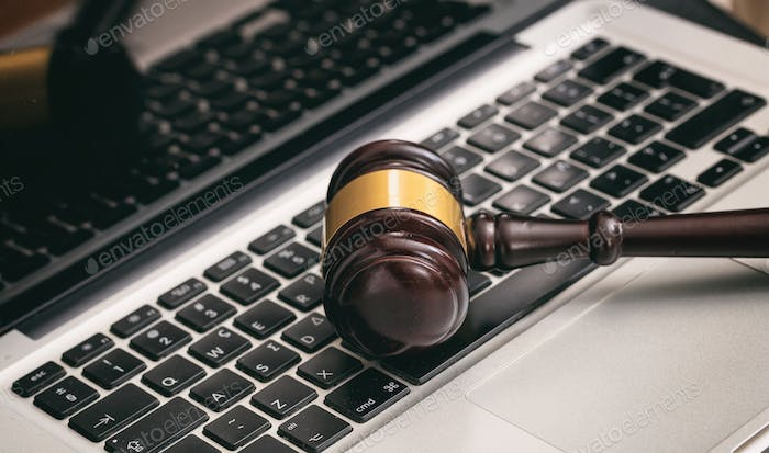 Auction or Judge gavel on a laptop