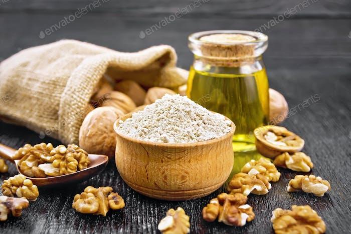 Flour walnut in bowl on board
