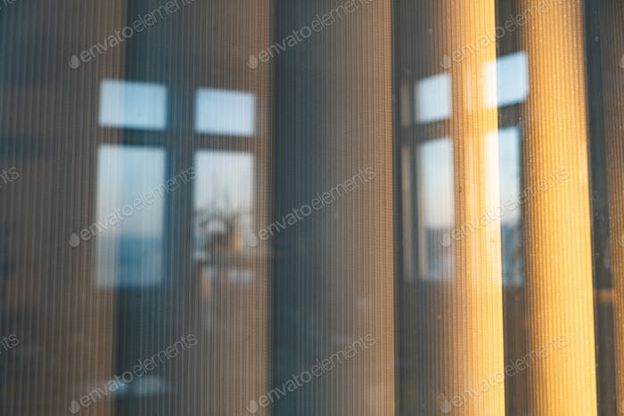 Vertical blinds outside the window