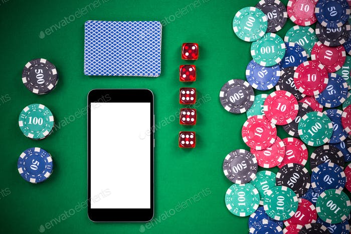 Mobile phone on casino poker table, on line gaming mock up templ