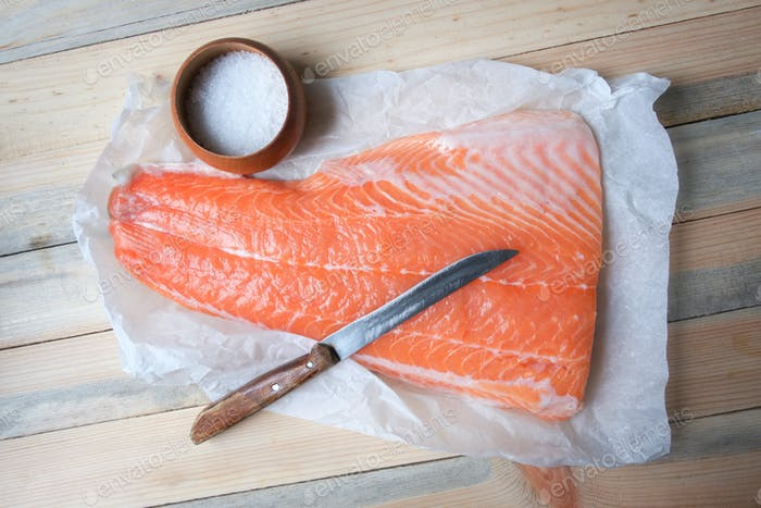 Fillet of salmon fish on wooden table
