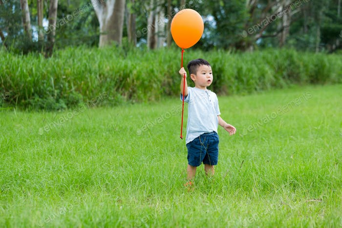 Little boy catch with balloon