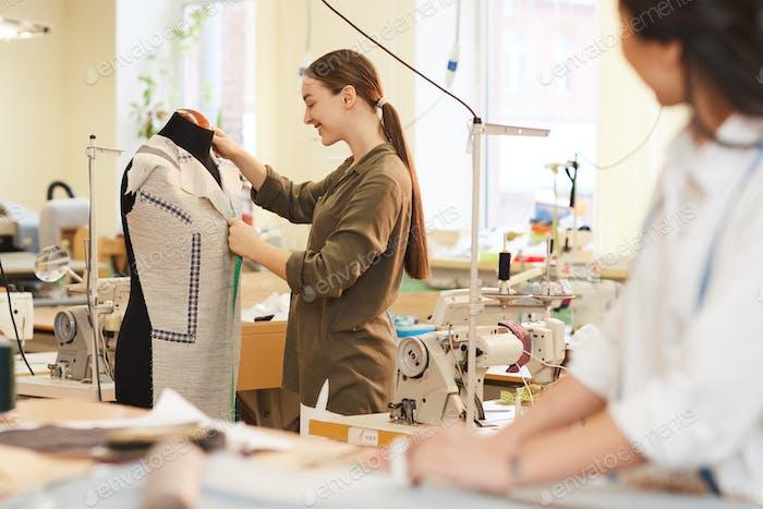 Designer working with mannequin
